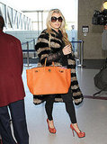 Pregnant Jessica Simpson wearing an Elizabeth and James rabbit fur jacket.