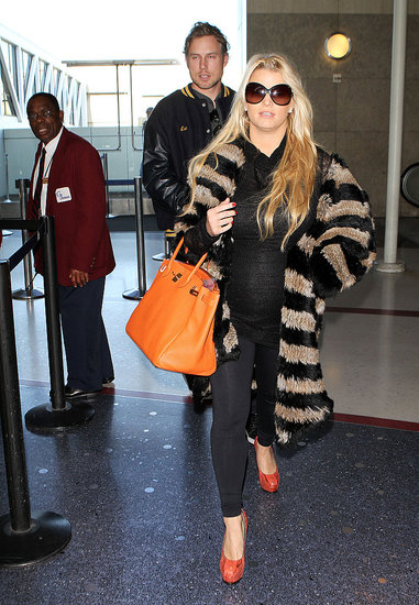 Jessica Simpson Wraps Her Bump in Fur For a Trip With Eric Johnson