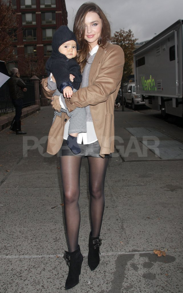 Miranda Kerr and Flynn Bloom wrapped in layers for a cool Winter day in NYC.