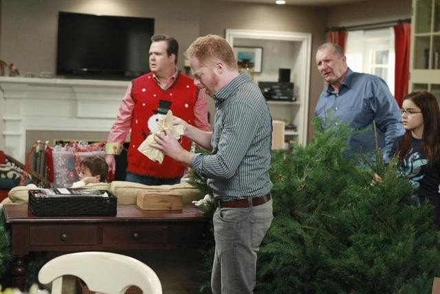 Eric Stonestreet as Cam, Jesse Tyler Ferguson as Mitchell, Ariel Winter as Alex, and Ed O'Neill as Jay on Modern Family.  Photo copyright 2011 ABC, Inc.