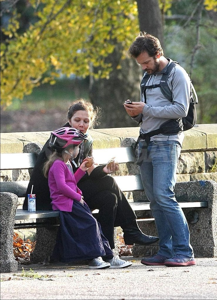 Possibly pregnant Maggie Gyllenhaal cozied up with her daughter, Ramona, and her husband, Peter Sarsgaard.
