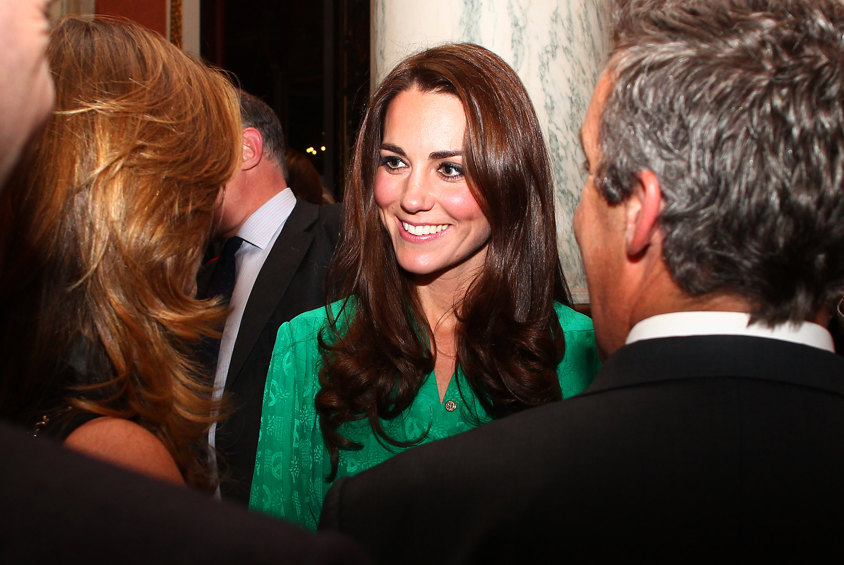 Kate Middleton in a green dress.