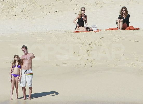 Shirtless Rande Gerber walked Kaia to the ocean in Mexico, while Cindy Crawford watched from the beach.