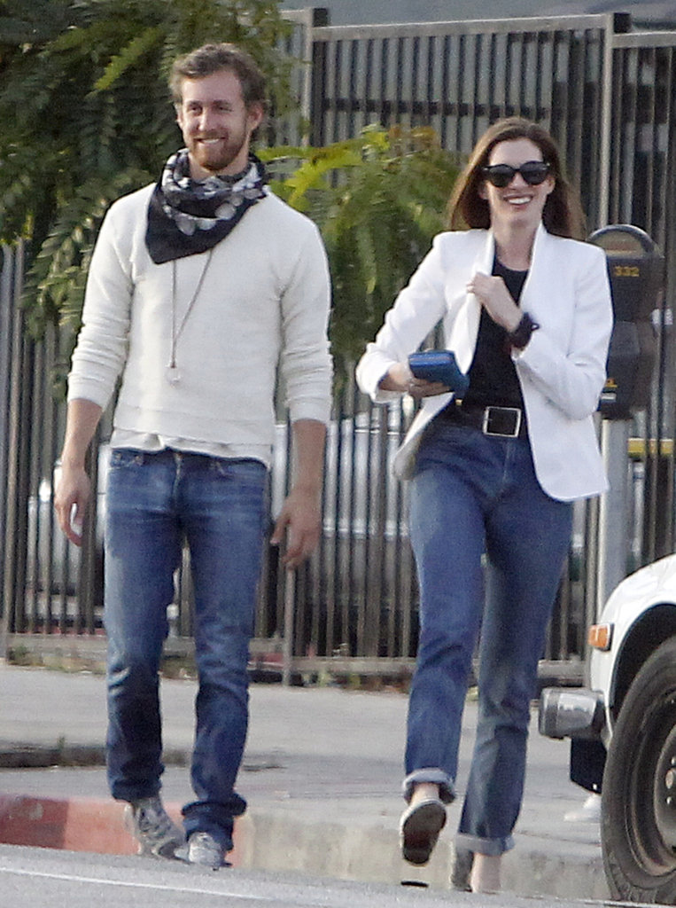 Adam Shulman and Anne Hathaway wore matching white arriving at a friend's house in LA in September 2011.