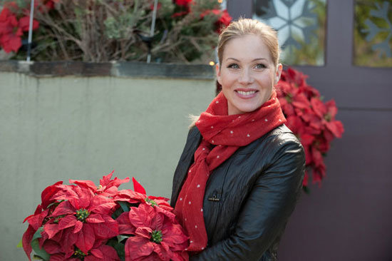 Reagan keeps warm in a scarf that matches perfectly with her poinsettias.  Photo courtesy of NBC