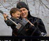 Tom Brady pushed Benjamin Brady on a swing set.