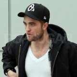 Robert Pattinson wore a cap at LAX.