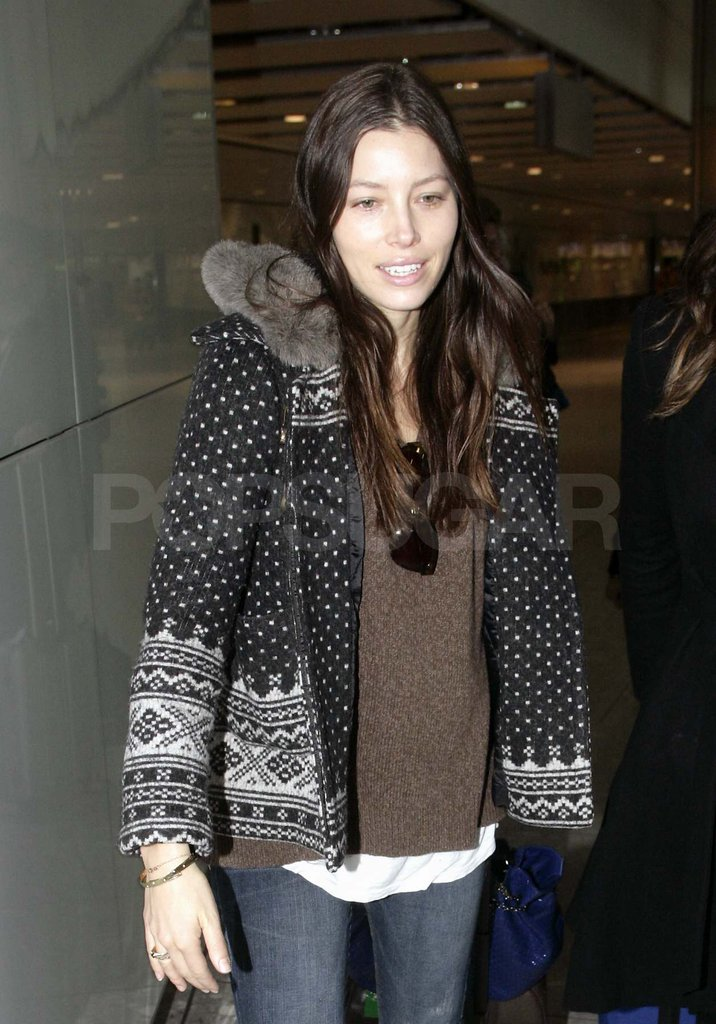 Jessica Biel in a festive sweater at Heathrow.