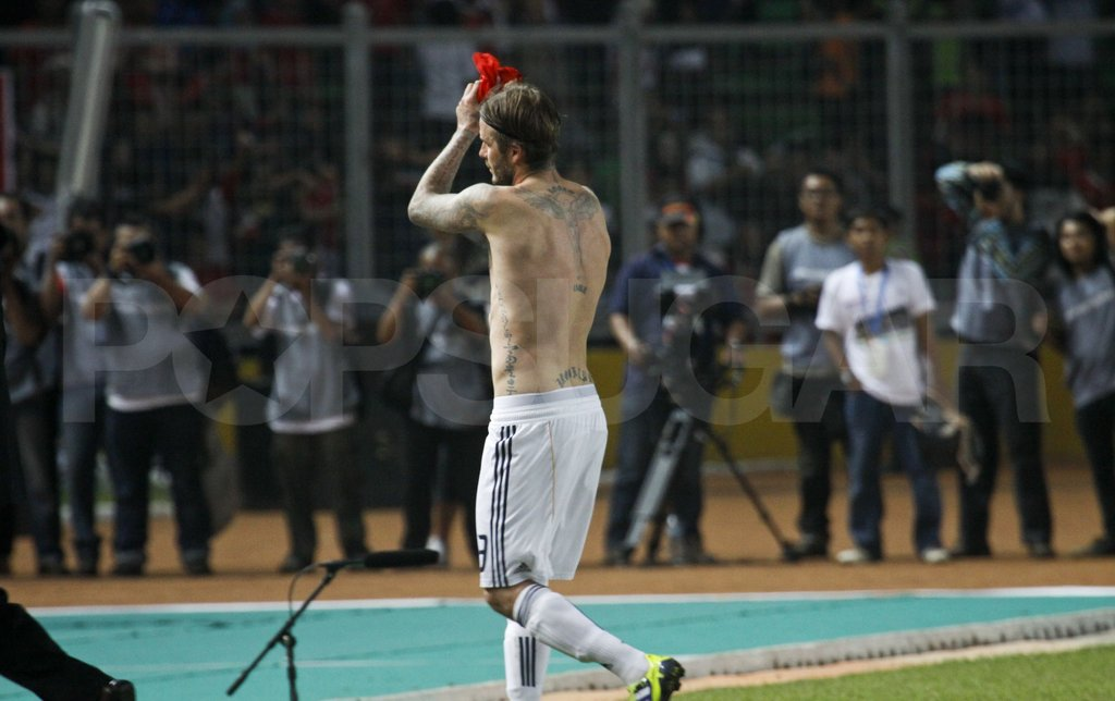 David Beckham was shirtless — and looking hot — in Indonesia.