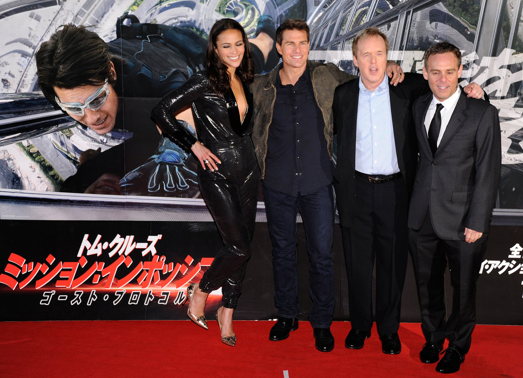 Tom Cruise and Paula Patton took a photo with Brad Bird and Bryan Burk for Mission: Impossible — Ghost Protocol.