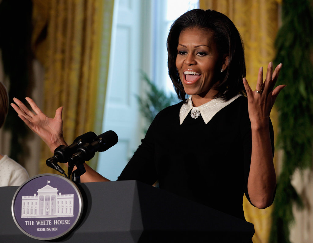 Michelle Obama delivers remarks during the first viewing of the 2011 White House Christmas decorations.