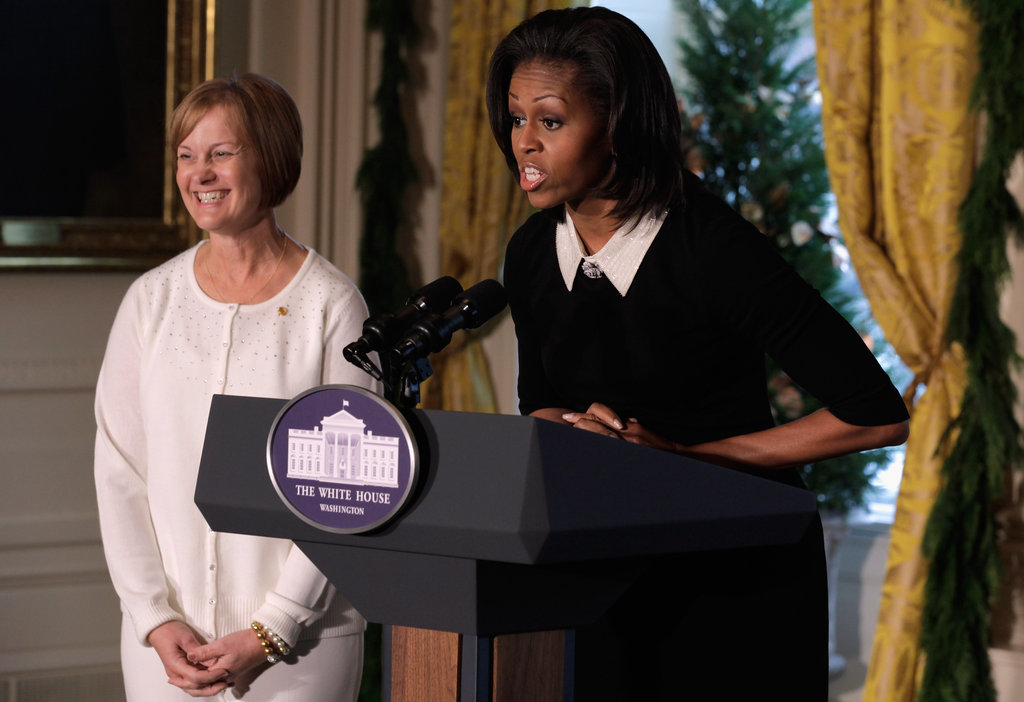 Michelle Obama delivers remarks during the first viewing of the 2011 White House Christmas decorations with Gold Star Mother Jennifer Jackman, whose son Ryan Jackman was killed on active duty.