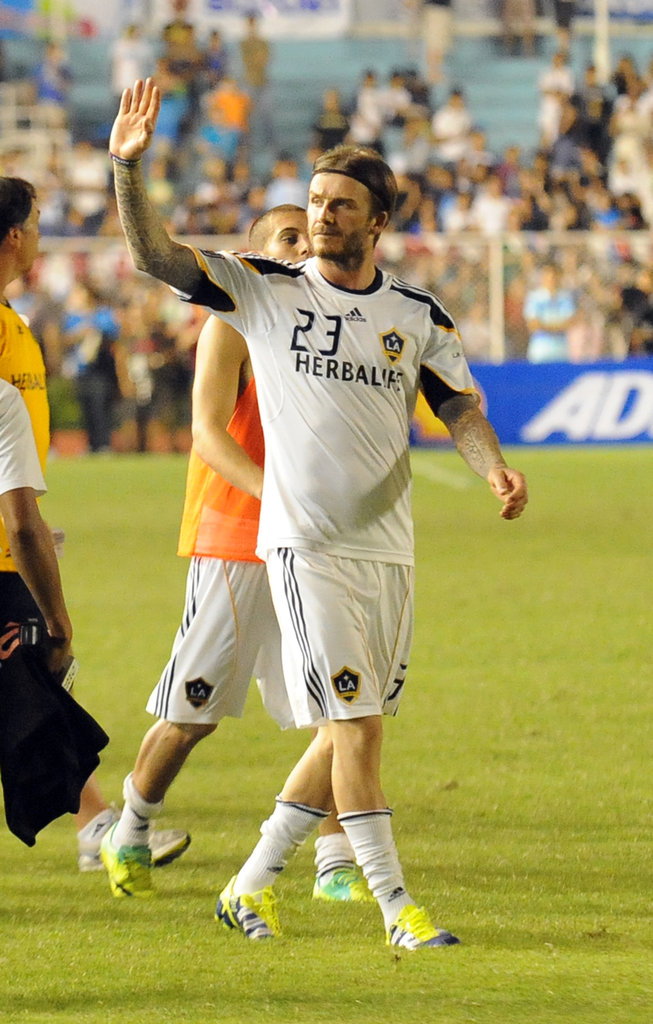 David Beckham left the field Friday night waving to fans.