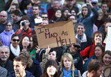 "A woman held up a sign saying ""I'm mad as hell"" during Occupy Vancouver protest."