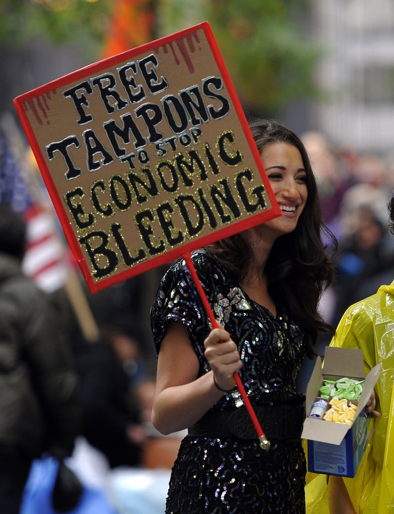 "This woman in New York handed out tampons to stop ""economic bleeding."""