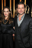 Angelina Jolie and Brad Pitt put their arms around each other at NYC's Standard Hotel.