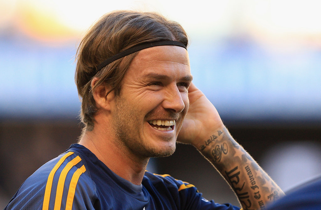 David Beckham laughed at practice.