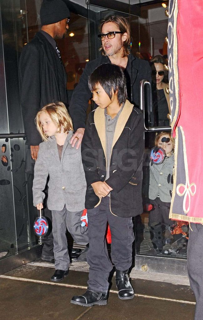 Brad Pitt and Angelina Jolie took the kids toy shopping in NYC.