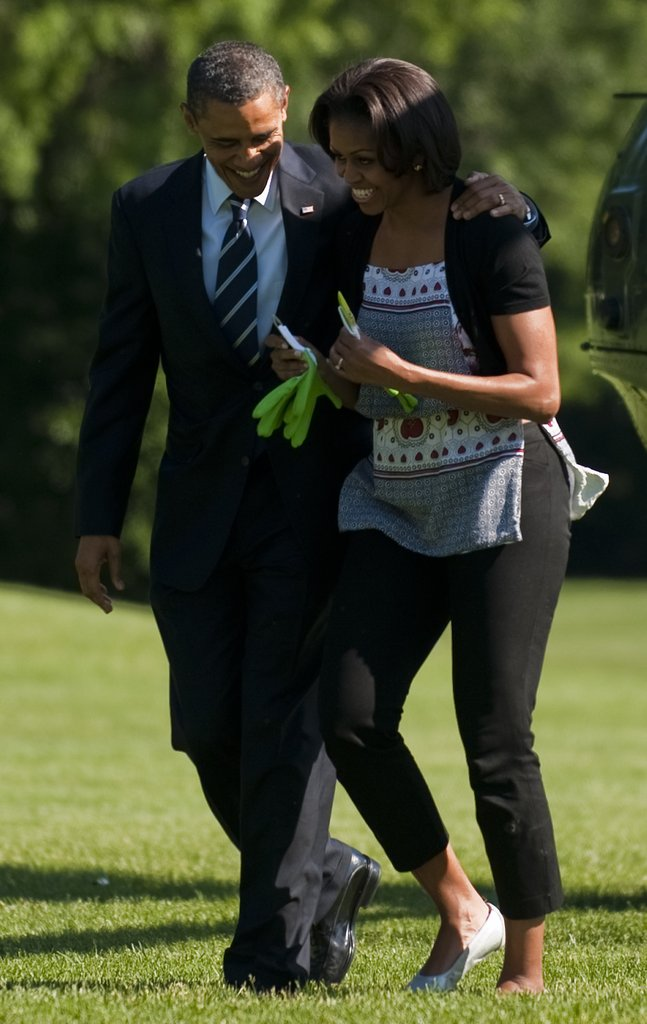 Barack gives Michelle a pair of gardening gloves.