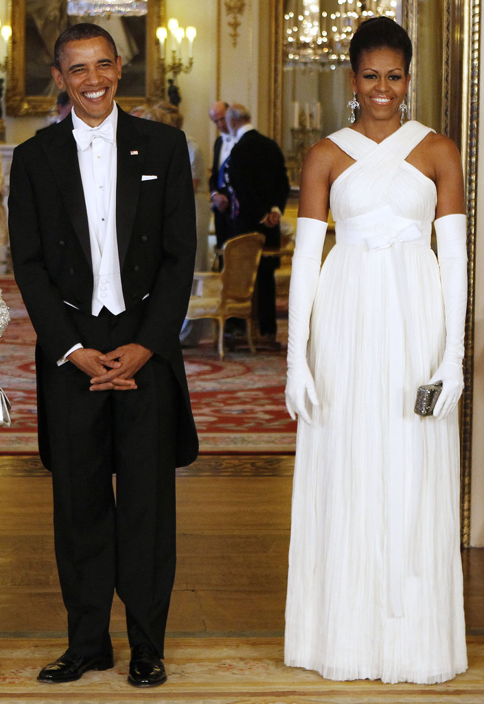 Barack is all smiles with a glamorous Michelle by his side.