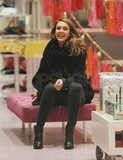 Jessica Alba took a seat to try on some shoes.