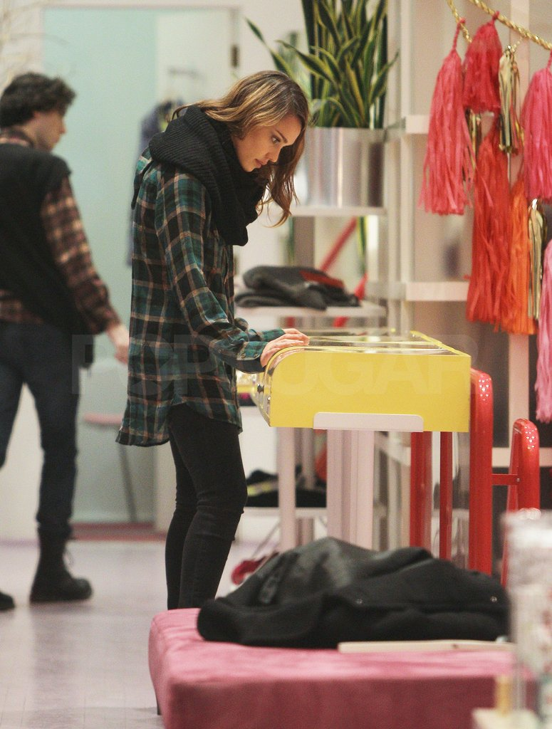 Jessica Alba kept warm in a scarf and cozy plaid shirt.