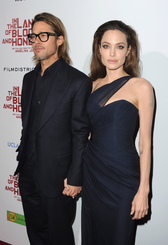 Angelina Jolie and Brad Pitt held hands.