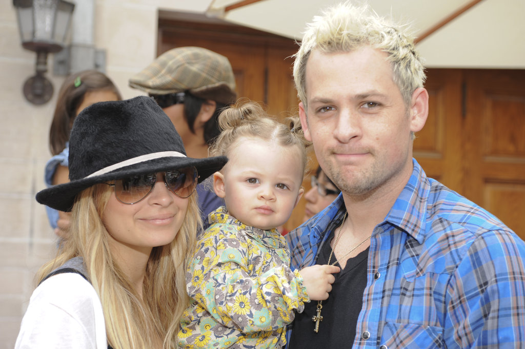 Nicole Richie and Joel Madden posed with daughter Harlow at a Beverly Hills festival in May 2009.