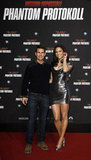 Paula Patton and Tom Cruise were happy to show Mission: Impossible — Ghost Protocol in Germany.