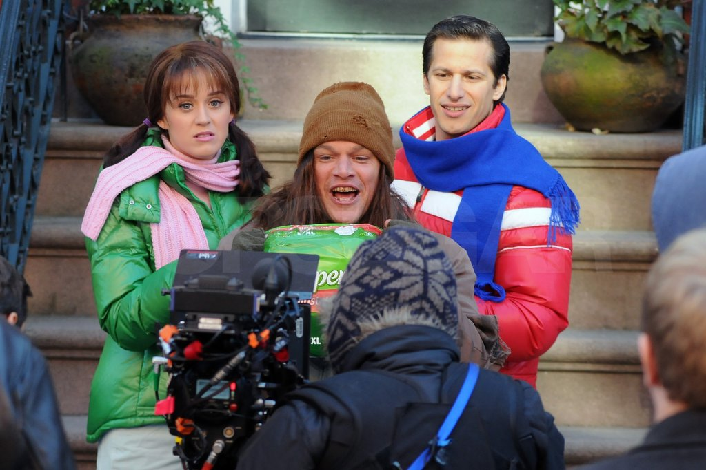 Katy Perry and Andy Samberg stood by while Matt Damon ran off with some props.