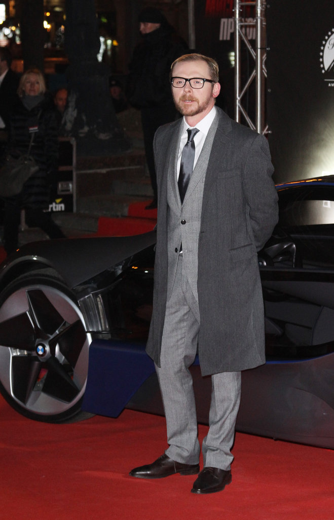 Simon Pegg layered a warm jacket over his suit in Moscow.