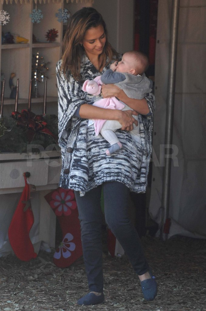 Jessica Alba carries Haven at the Christmas tree lot.