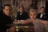 Tobey Maguire as Nick Carraway, Leonardo DiCaprio as Jay Gatsby, Carey Mulligan as Daisy Buchanan, and Joel Edgerton as Tom Buchanan in The Great Gatsby.