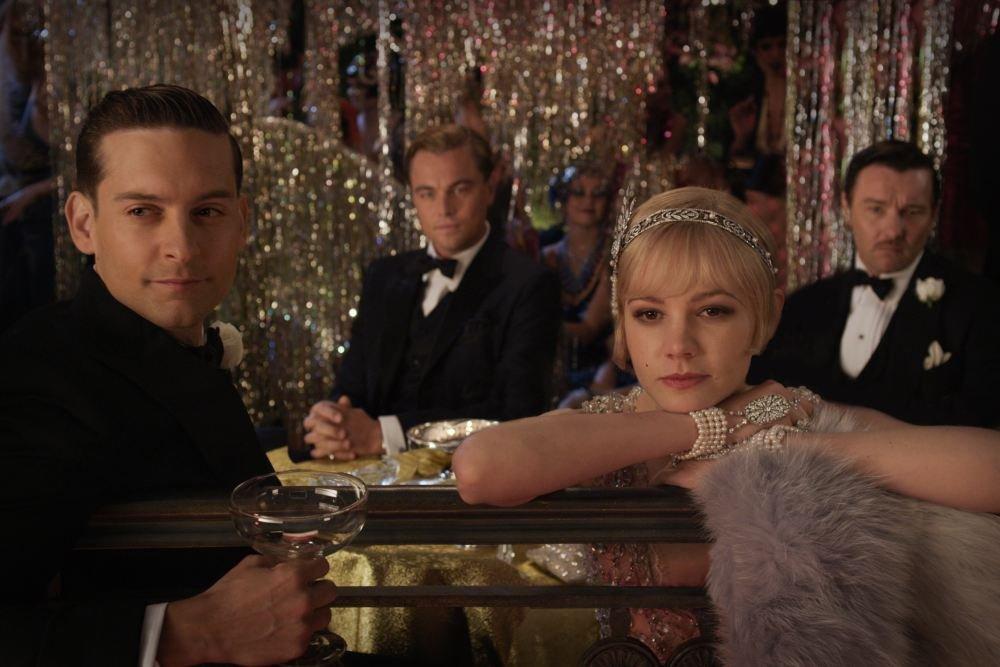 Tobey Maguire as Nick Carraway, Leonardo DiCaprio as Jay Gatsby, Carey Mulligan as Daisy Buchanan, and Joel Edgerton as Tom Buchanan in The Great Gatsby.