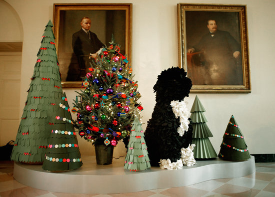 Deck the halls with boughs and . . . Bo? The family pooch took center stage at a reception for military families at which the first lady revealed this year's amazing holiday decorations. The Bo replicas came in all sizes and materials: from tiny dogs made of buttons to life-sized models crafted from felt and garbage bags. Source: Getty Images