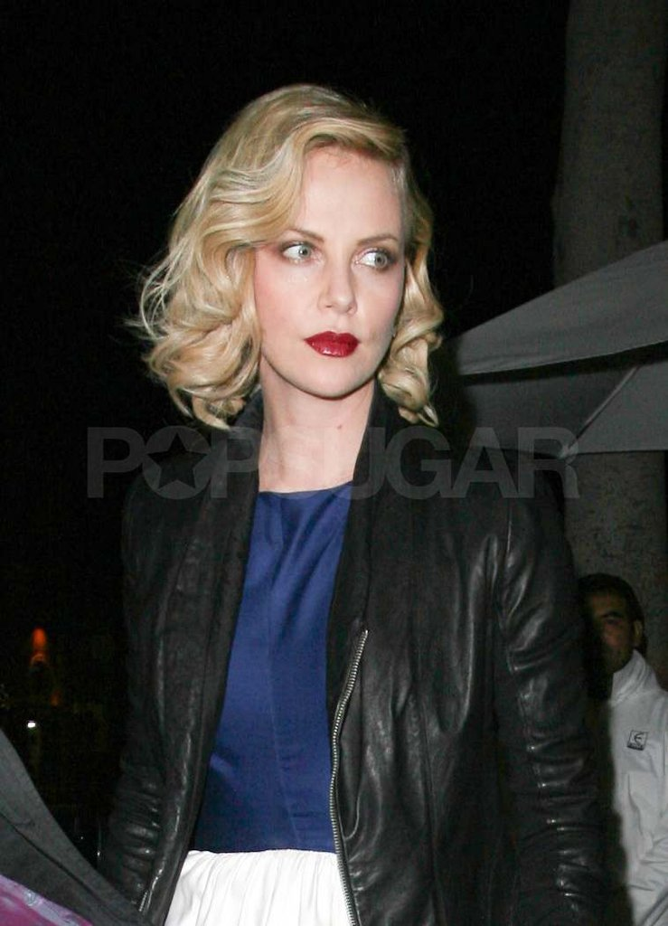 Charlize Theron with red lipstick.