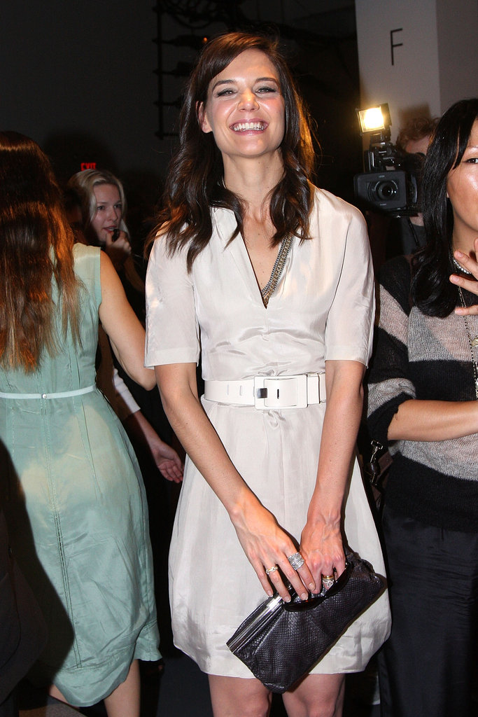 Katie Holmes flashed a huge grin while backstage at the Calvin Klein runway show in September 2010.