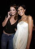 Katie Holmes paused her phone call for a photo with Mandy Moore while backstage at the MTV Movie Awards in June 2002.