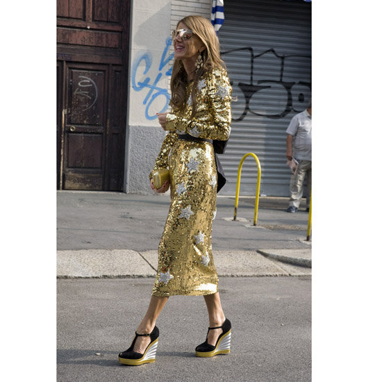 Anna Dello Russo went star-spangled in a tea-length Dolce & Gabbana sequin dress and YSL wedges during Spring 2012 Milan Fashion Week Shop the look:  Photo: Phil Oh