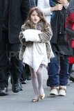 Suri Cruise wore a faux fur jacket around NYC.