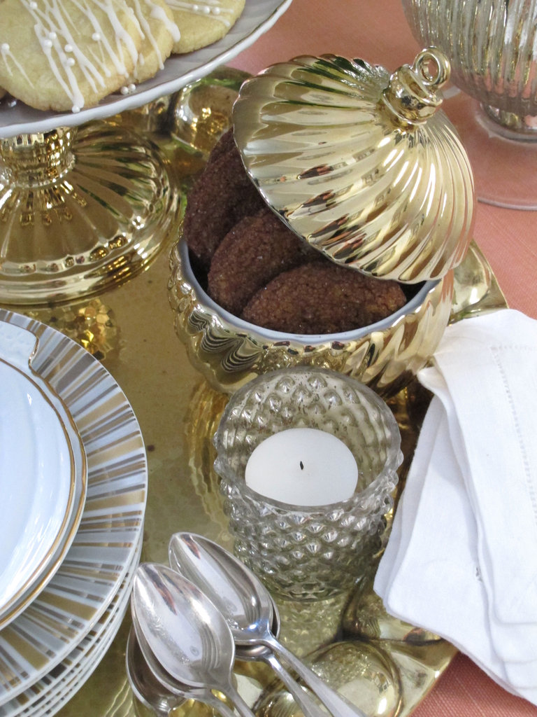 Gold-coated porcelain ornament bowls ($10) are a seasonally relevant way to serve chocolate-dusted dragées.