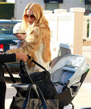 Rachel Zoe got help setting up her stroller, while she held onto baby Skyler.