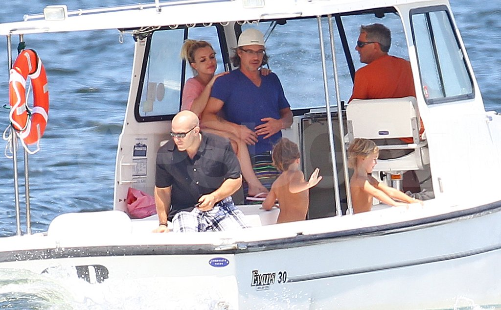 Britney cuddled up to Jason while on a boat ride in NY with Sean and Jayden in August 2011.