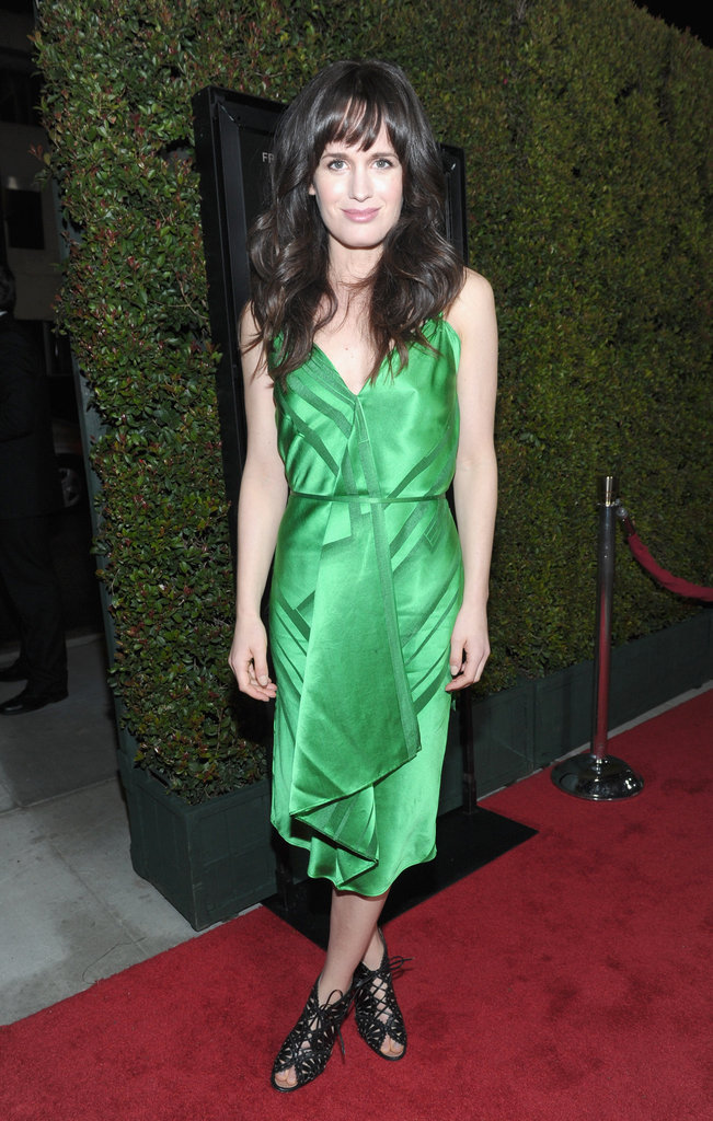 Elizabeth Reaser in a green silk cocktail dress.