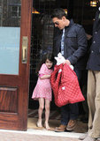 Suri Cruise didn't seem to want to wear her red coat.