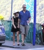 Reese and Jim held hands while on a scenic stroll during their Italian honeymoon in July.