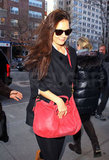 Katie Holmes carried a little red bag home from her NYC dance class and rocked The Girls leggings.