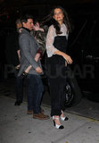 Katie Holmes led the way to her birthday dinner with husband Tom and daughter Suri.