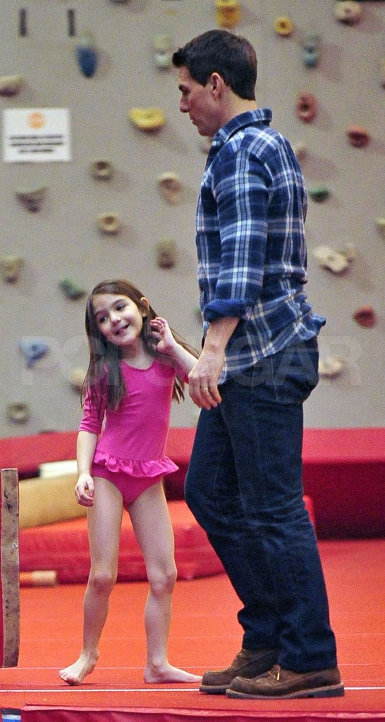 Tom Cruise and Suri Cruise smiled together.