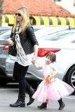 Sarah Michelle Gellar held her daughter Charlotte Prinze's hand.